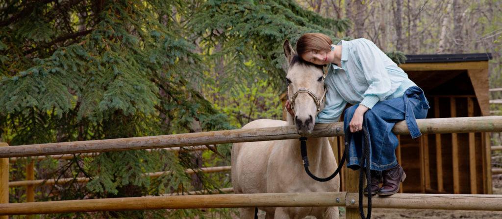 Marianne snuggling horse